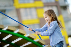 Little girl having fun at a playground Stock Image