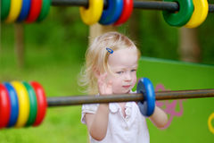 Little girl having fun at a playground Royalty Free Stock Photography