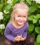 Little girl having fun playing. In garden Stock Photo