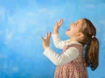 Little girl having fun playing Royalty Free Stock Images