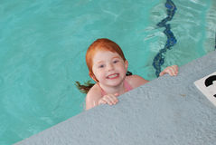 Little Girl Having Fun in Pool Stock Photography
