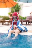 Little girl having fun in the pool. Summer holidays and vacation. Concept Royalty Free Stock Photo