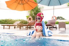 Little girl having fun in the pool. Summer holidays and vacation. Concept Stock Image