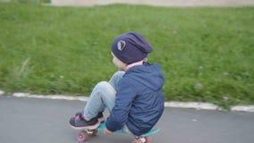 Girl riding cruiser board stock video footage