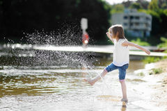 Little girl having fun by a river Royalty Free Stock Images