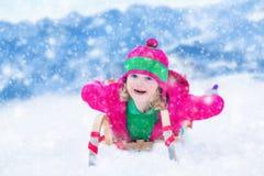 Little girl having fun at sleigh ride Stock Photos