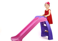 Little girl having fun on slide isolated Royalty Free Stock Images