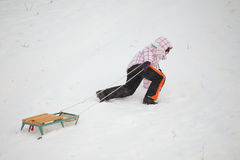 Little girl having fun in snow Stock Photos