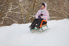 Little girl having fun in snow Royalty Free Stock Images