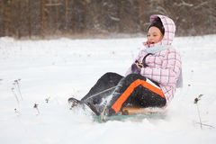Little girl having fun in snow Stock Photos