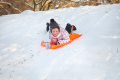 Little girl having fun in snow Stock Photography