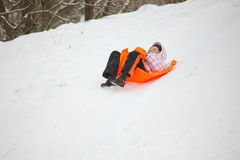Little girl having fun in snow Royalty Free Stock Photo