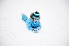 Little girl having fun in the snow Stock Image