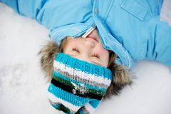 Little girl having fun in the snow Stock Photography