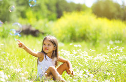 Little girl having fun in summer day Stock Photography