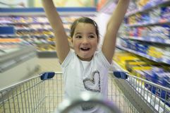 Little girl having fun at supermarket royalty free stock photo