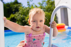 Little girl having fun in swimming pool Royalty Free Stock Images