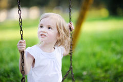 Little girl having fun on a swing Royalty Free Stock Photography