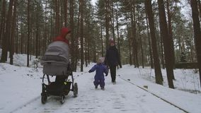 Little girl having fun together with mother and grandmother on winter day stock footage