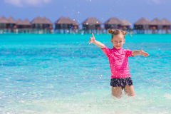 Little girl having fun on tropical beach with Royalty Free Stock Photography