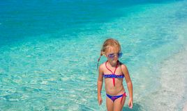 Little girl having fun on tropical beach with Stock Image