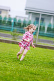 Little girl having fun under the rain Royalty Free Stock Photo