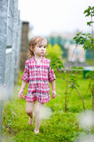 Little girl having fun under the rain Royalty Free Stock Image