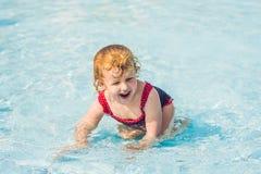 Little Girl having fun in the water park stock photos