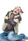 Little Girl Having Fun Wearing Santa Hat Stock Photos