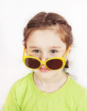 Little girl having fun wearing sunglasses on her nose Royalty Free Stock Image