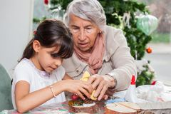 Free Little Girl Having Fun While Making Christmas Nativity Crafts With Her Grandmother Stock Image - 164390561