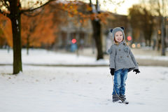 Little girl having fun at winter city Stock Image