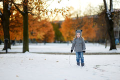 Little girl having fun at winter city Stock Images