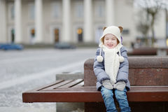 Little girl having fun on winter day Stock Photo