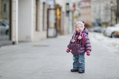 Little girl having fun on winter day Royalty Free Stock Photos