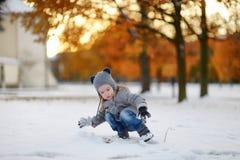Little girl having fun on winter day Stock Photos