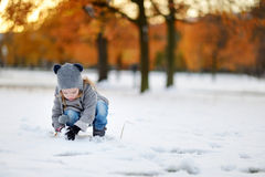 Little girl having fun on winter day Stock Image