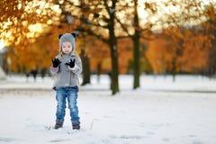 Little girl having fun on winter day Stock Image