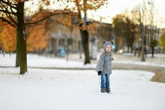 Little girl having fun on winter day Stock Images
