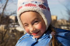 Little girl having fun in winter day Royalty Free Stock Image