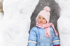 Little girl having fun in winter snow cave Royalty Free Stock Photos