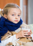 Little girl having heavy quinsy in domestic interior Stock Photography