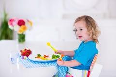Little girl having lunch Stock Image