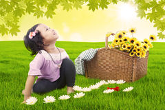 Little girl having picnic Stock Photos