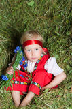 The little girl  on hay Stock Photography