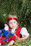 The little girl  on hay Royalty Free Stock Image