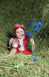 The little girl  on hay Royalty Free Stock Images