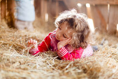 Little Girl in Hay Royalty Free Stock Photography
