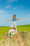 Little girl on haystack. Royalty Free Stock Image