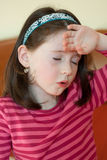Little girl with headache Stock Photos